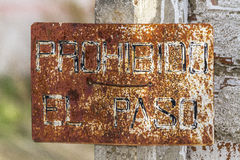 Poster rusty iron. Rusty iron sign with the legend of trespassing Royalty Free Stock Photography