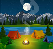 Poster showing campsite with a campfire. A poster showing a campsite with a campfire. Vector flat theme of Climbing, Trekking, Hiking, Walking. Sports, Camping Royalty Free Stock Images