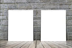 Poster stand on wooden floor with brick wall. Royalty Free Stock Image