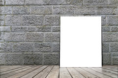 Poster stand on wooden floor with brick wall. Royalty Free Stock Images