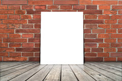 Poster stand on wooden floor with brick wall. Stock Images