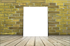 Poster stand on wooden floor with brick wall. Royalty Free Stock Photo