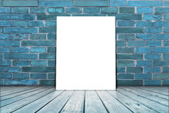 Poster stand on wooden floor with brick wall. Stock Photo