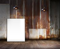 Poster stand on wooden floor and Old rusty zinc background. You can write some word on poster stand Stock Photo