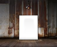 Poster stand on wooden floor and Old rusty zinc background. You can write some word on poster stand Stock Photos