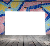Poster standing on mosaic tile with Ceiling lamp Royalty Free Stock Photo