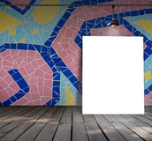 Poster standing on mosaic tile with Ceiling lamp Royalty Free Stock Images