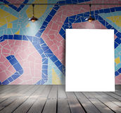 Poster standing on mosaic tile with Ceiling lamp Stock Image