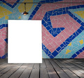Poster standing on mosaic tile with Ceiling lamp Stock Photo