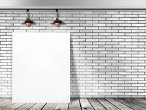 Poster standing in White Brick wall Stock Images