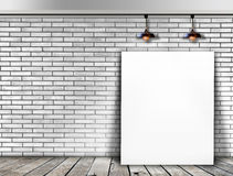 Poster standing in White Brick wall Royalty Free Stock Photography