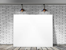 Poster standing in White Brick wall Royalty Free Stock Photo