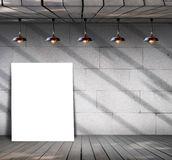 Poster standing on wood floor with Grungy concrete wall Royalty Free Stock Image