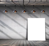 Poster standing on wood floor with Grungy concrete wall Stock Photography