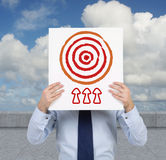 Poster with target. Businessman holding poster with target Royalty Free Stock Image