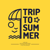 Poster with the text trip to summer, beach umbrella Stock Photo
