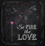 Poster Valentines Day  lettering Set fire the love. Poster Valentines Day with chalk on the blackboard shown with a match lettering Set fire the love Stock Photos