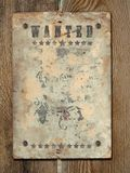 Poster Wanted. Wild West styled poster.Old Paper Texture On a old wooden boards royalty free stock photography