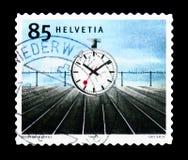 Postera klockan (1944) som planläggs av Hans Hilfiker (1901-93), schweizare Arkivbild