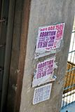 Posters for abortion on a wall in Johannesburg. Handbills for abortion services on a wall in Johannesburg, South Africa Royalty Free Stock Photos