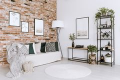 Posters in bright living room stock images