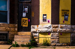 Posters on the front of an abandoned house in Baltimore, Marylan Stock Photos