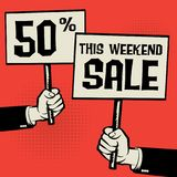 This Weekend Sale - 50 percent. Posters in hands, business concept with text This Weekend Sale - 50 percent, vector illustration Stock Photos