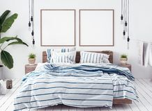 Posters mock-up in new Scandinavian boho bedroom. 3d render royalty free stock image
