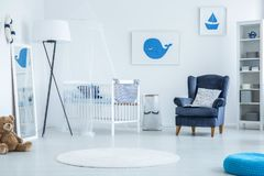 Posters with whale and boat. Cute posters with blue whale and boat hanging on white wall in kid`s bedroom royalty free stock photography