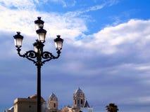 Postes de luz no por do sol em Cadiz andalusia spain imagem de stock royalty free