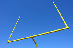 Postes do futebol americano sobre o céu azul Imagem de Stock Royalty Free