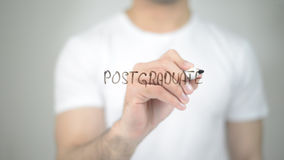 Postgraduate, man writing on transparent screen Stock Photo