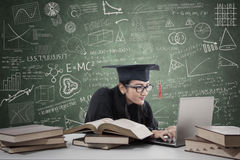 Postgraduate studying in class 2 Stock Photos
