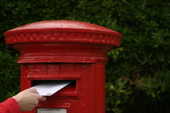 Posting a letter. Someone posting a letter. Would make ideal 'contact us' graphic Stock Photography