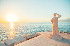 POSTIRA, CROATIA - JULY 12, 2017: Famous monument of person looking into a horizon in a small town Postira - Croatia, Brac island. POSTIRA, CROATIA - JULY 12 Stock Photos