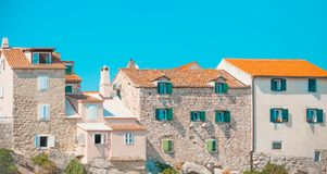 POSTIRA, CROATIA - JULY 18, 2017: Lots of beautiful old houses built on rock in the harbor of a small town Postira - Croatia, Brac. POSTIRA, CROATIA - JULY 18 Stock Images