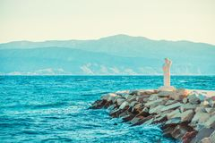 POSTIRA, CROATIA - JULY 14, 2017: Monument of person looking into a horizon from a small town Postira - Croatia, Brac island. POSTIRA, CROATIA - JULY 14, 2017 Royalty Free Stock Photos