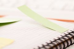 Postit attached to a notebook Royalty Free Stock Photos