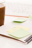 Postit attached to a notebook Royalty Free Stock Photo