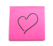 Postit heart. Post it note with heart symbol as concept for office romance. Suitable for St Valentine's Day Royalty Free Stock Photo