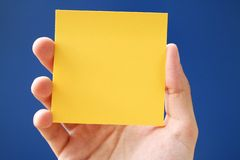 Postit note over blue Royalty Free Stock Photography