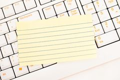 Postit notes on a keyboard Stock Image