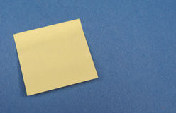 Postit over blue with copy space Stock Photo