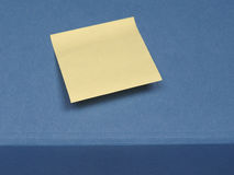 Postit over blue with copy space Stock Images