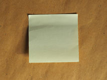 Postit over brown with copy space Royalty Free Stock Image