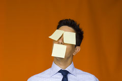 Postit over the face. A bussiness man with tree post'it over his face royalty free stock images