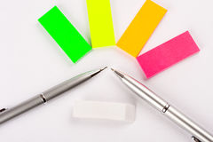 Postit and pens Stock Photos