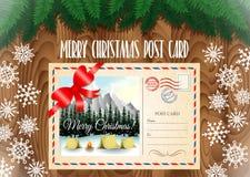 Postkarte der frohen Weihnachten auf der hölzernen Tabelle mit Weihnachtsbaumasten und -schneeflocken Lizenzfreies Stockbild