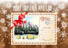 Postkarte der frohen Weihnachten auf der hölzernen Tabelle und den Schneeflocken Lizenzfreie Stockfotos