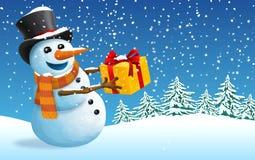 Postkarten-Weihnachts- und des neuen Jahresschneemann mit Geschenk Lizenzfreie Stockfotos